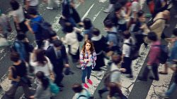 Woman in Middle of bustling crowd