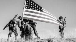 Military raising a flag