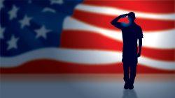Man saluting flag